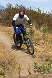 Biker on downhil race