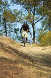 Mountain biker girl on downhill race