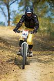 Girl on mountain bike downhill race