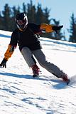 Fast mountain skier downhill on ski resort slope