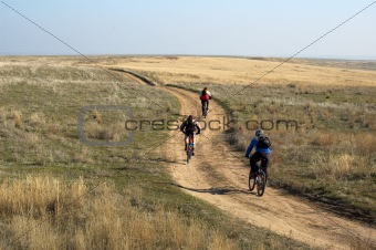 Three mountain bikers