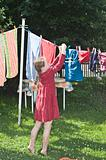girl hanging clothes to dry