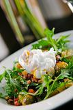 Boiled egg on salad