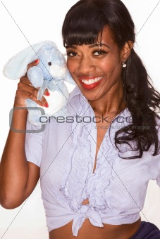 Smiling Black girl with blue bunny