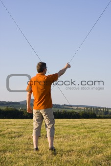 Man pointing with outstretched arm