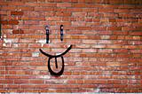 Brick Wall and Smile Graffiti - Smile Graffiti on a Red Brick Wall.