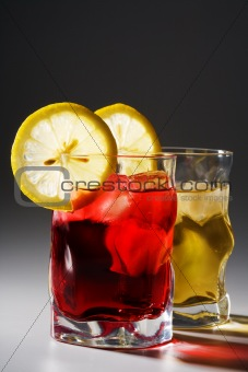 cocktail, a lemon and an ice