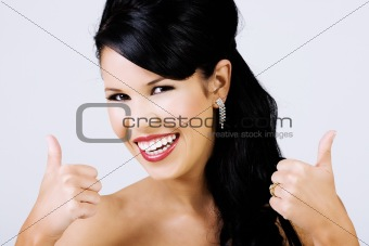 Thumbs up from beautiful smiling woman