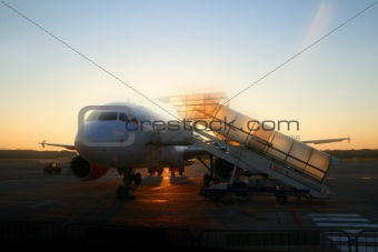 Airplane and sunrise