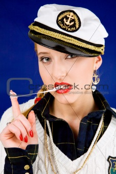 Blond young woman with chewing gum