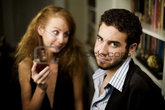 Woman looks lovingly at young man
