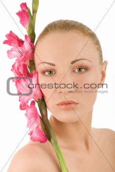 Spa woman with gladiolus