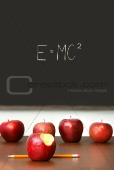 Apples on top of school desk