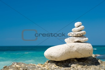 stacked pebbles on the beach