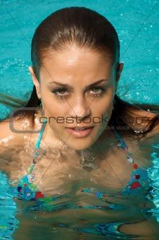 Beautiful woman in a swimming pool.