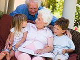 Grandparents reading to grandchildren