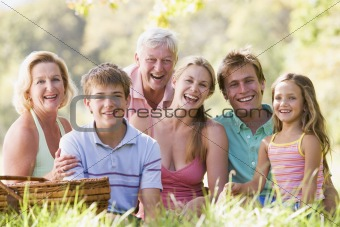 Family at a picnic smiling