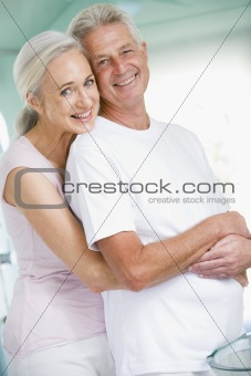 Couple embracing at a spa and smiling
