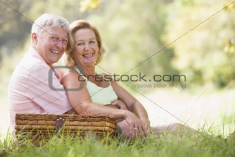 Couple at a picnic smiling
