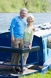 Couple outdoors on a boat smiling