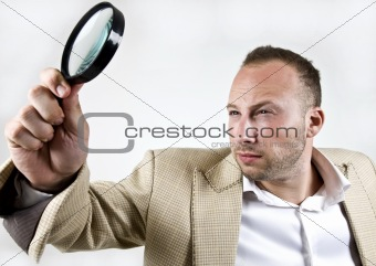 male with magnifying glass