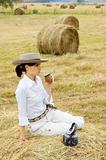 Farm Girl Drinking Mate in a Field