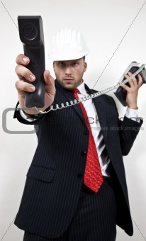 architect holding phone receiver