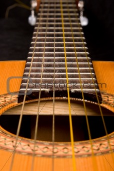 Classical guitar close up on dark