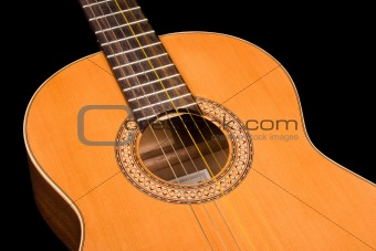 Classical guitar close up on dark