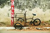 Tricycle chained to a post in Nicaragua