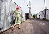 Woman with Pink Hair and a Purse in an Alley