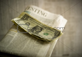 close up of money on newspaper