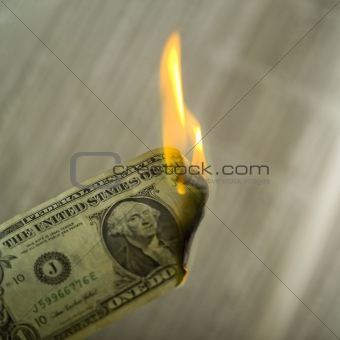 close up of money on fire