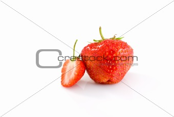 One whole and one half of tasty ripe red strawberry