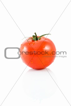 Single ripe red tomato