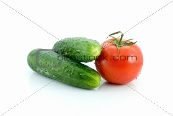 Single tomato and pair of cucumbers