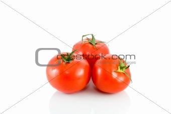 Three ripe red tomatoes