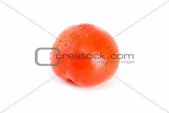 Single ripe tomato with drops of water