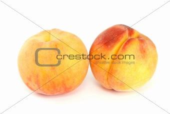 Pair of orange peaches