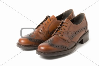 Two brown shoes isolated on white