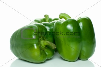 Three green sweet peppers