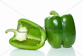 Green sweet pepper and half