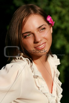 Green eyed girl with flower in her hair