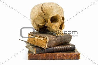 skull and old books