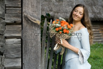 Beautiful smiling girl with a bouquet of roses