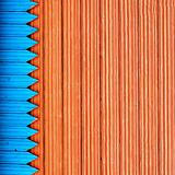 Composition with blue and red structure wooden planks
