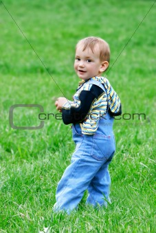 smiling baby boy on natural background