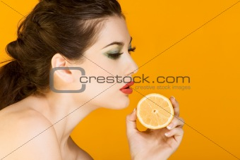 Beautiful brunette woman with slice of lemon