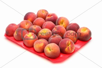 fresh peaches on white background