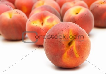 one peach on peaches background